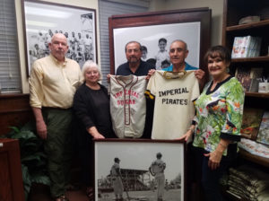 Photo of Sugar Land Heritage Foundation members with donated jerseys
