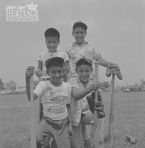 Photo of George Morales playing baseball with friends